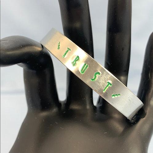 Trust green stamped cuff bracelet
