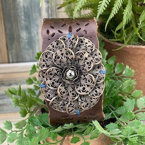 Filigree flower assemblage leather bracelet