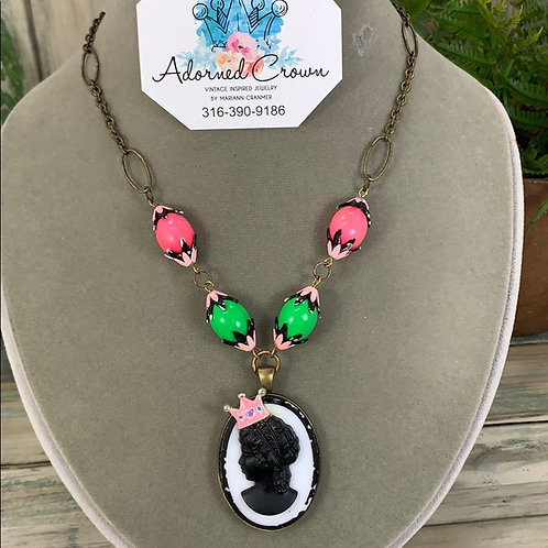 She's a cameo princess green pink necklace