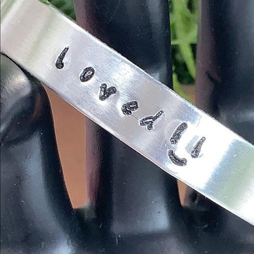 Loved smile stamped cuff bracelet