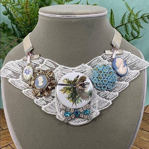 Blue bits & baubles collage lace blue bird necklace