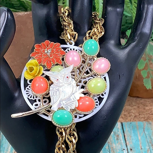 Orange Barn owl among the flowers assemblage necklace
