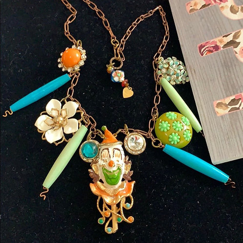 Orange green Laughing clown brightly colored necklace