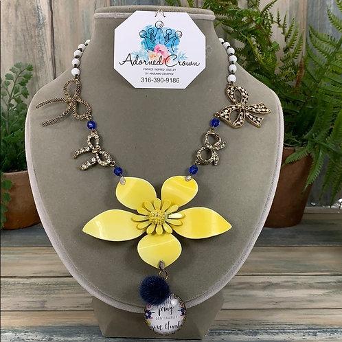 Yellow enamel flower bow pray necklace