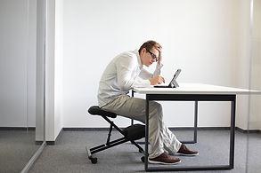 Stooped-on-kneeling-chair.jpg