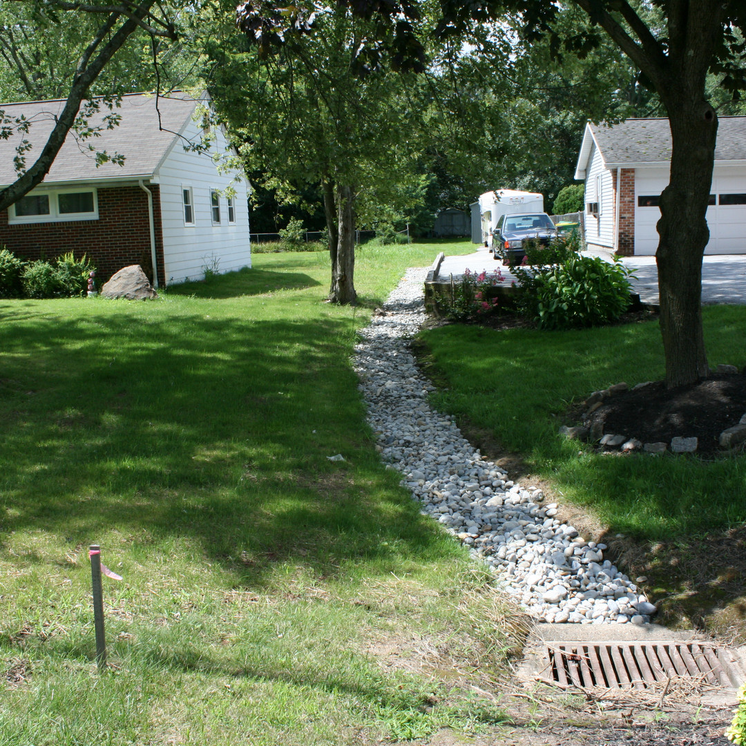 Underdrain and riprap swale to CB.JPG