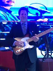 Playing a tele, wearing a suit...like you do.