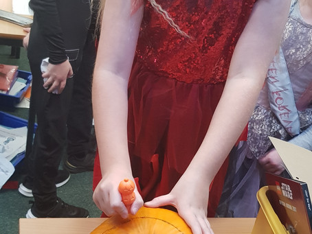 Miss Needham's 'Orrific Oak Class really enjoyed carving their pumpkin and seeking out their treats!