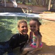 woman teaching kid to swim