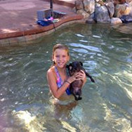 young girl and dog in pool