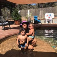 swim instructor with two children
