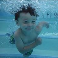 little boy enjoying pool