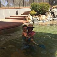 teaching young boy to swim