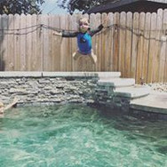 kid jumping into pool