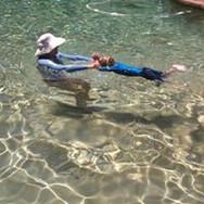 boy learning basic swimming instruction
