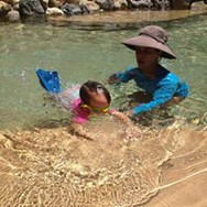 young child learning to swim in TN