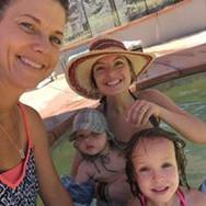 family enjoying pool