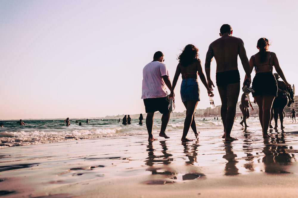 a blended family goes for a beach stroll