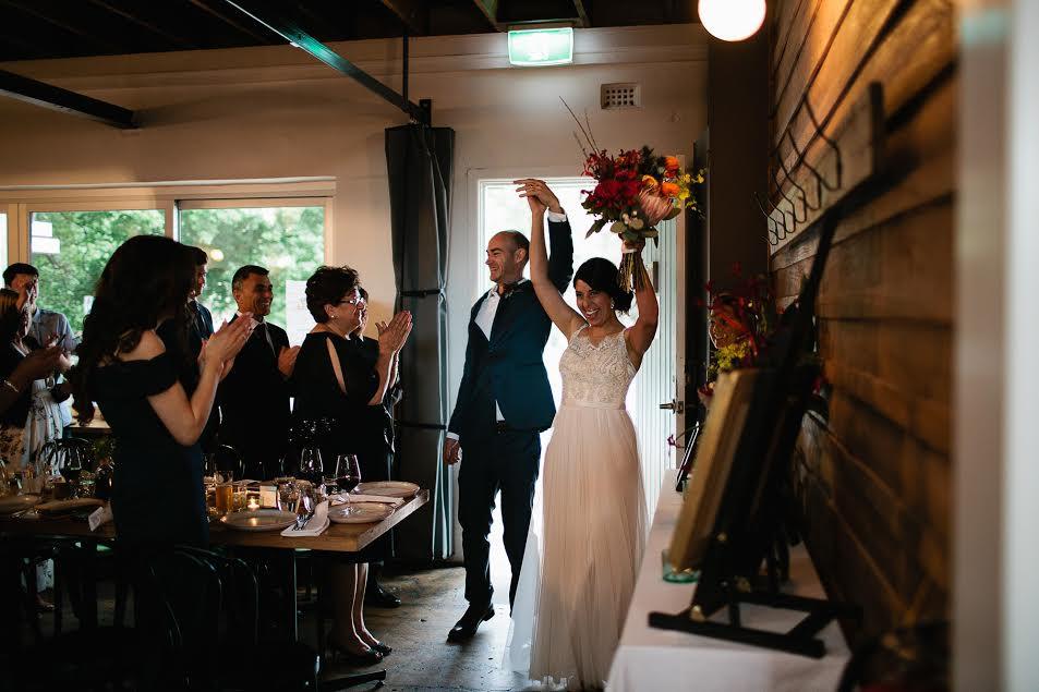bride and groom entering venue.jpg