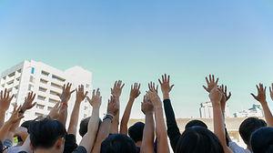 people raise hand.jpg