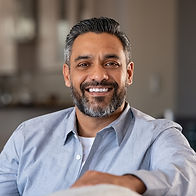 portrait-of-happy-indian-man-smiling-at-