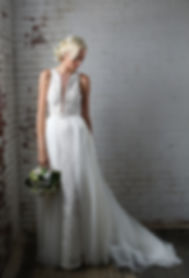Iris Gown with overskirt, a beaded lace chantilly gown with a deep v cut bodice Best seller, popular wedding dress
