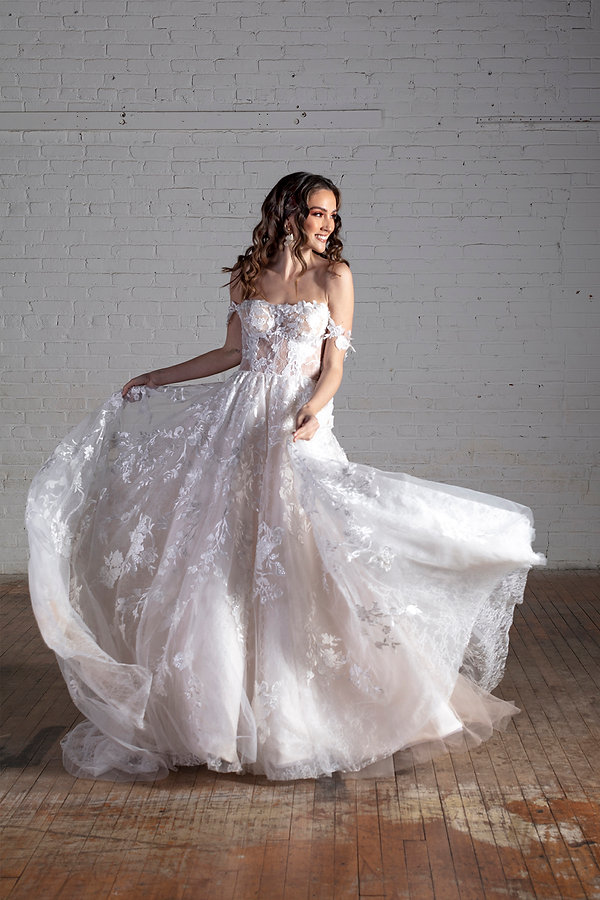 A stunning lace, off the shoulder bridal ballgown with lace appliques throughout.