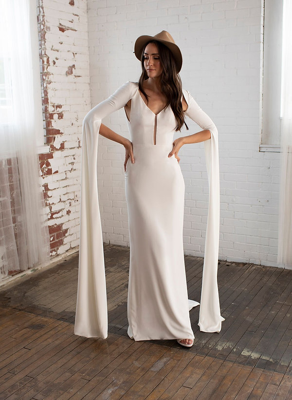 A floor length crepe wedding gown with matching bolero, long sleeve wedding gown with center slit and v neckline. Classy and unique wedding dress.