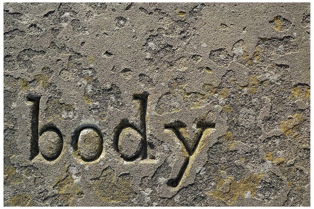 Corpse-pose-body-grave stone