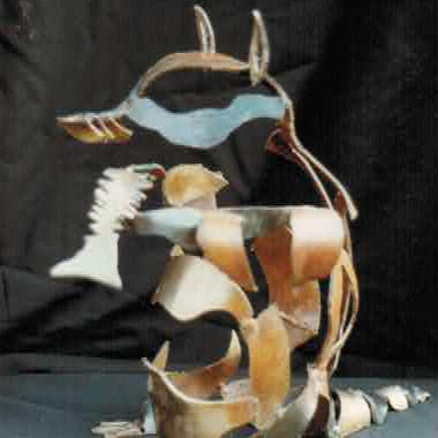 RACCOON is a bronze with a patina. He has a fish skeleton in his paws and his head bobs up and down as he nibbles.