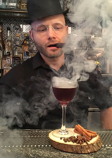 "Francesco Dionese presenting the cocktail ""the Smoking Reverend"""