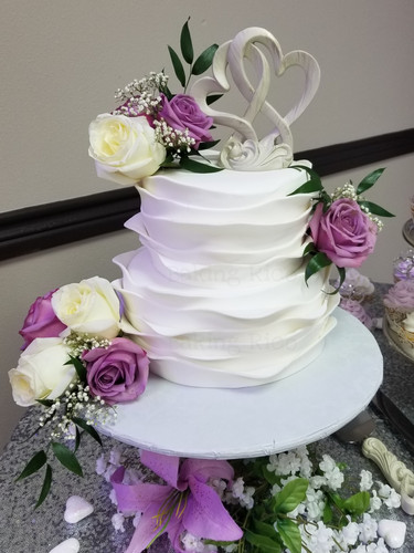 Wedding cake on with roses