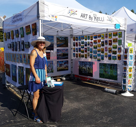 Kelli Greentree at her booth during a fine art fair