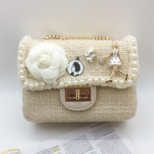 Cream Cute tweed bag with hand and shoulder gold chain.