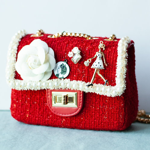 Red Cute bag with hand and shoulder gold chain.
