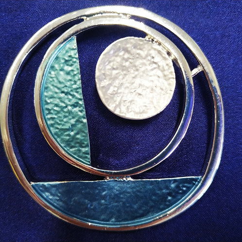 Cool magnetic Art Deco Circle brooch with in Blue and Silver .