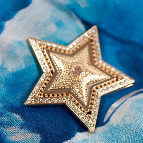 Cool magnetic star brooch with gold plate and clear jewels inlay.