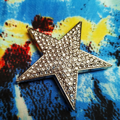 Cool magnetic star brooch with Silver plate and clear jewels inlay.