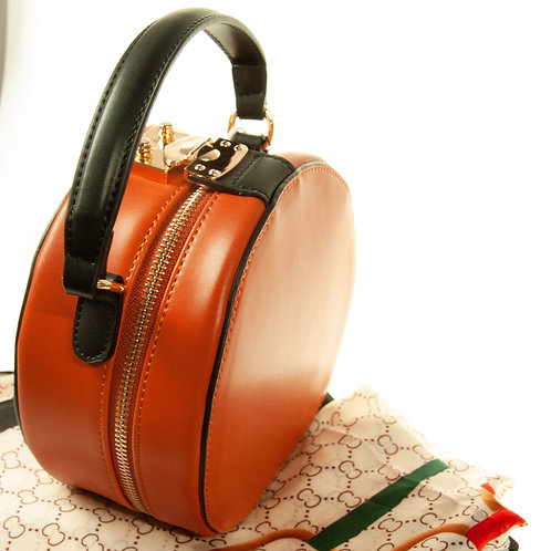 Faux Leather Crossbody round hat box bag.
