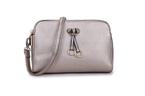 Metallic Silver Faux Leather Crossbody With Gold Embellishment.