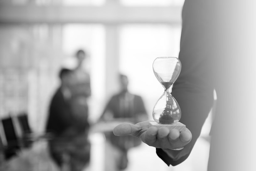 businessman-holding-hour-glass-signifies