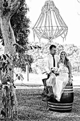 Bride and groom on rustc wine barrel