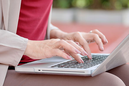 woman-typing-on-keyboard-of-computer-lap