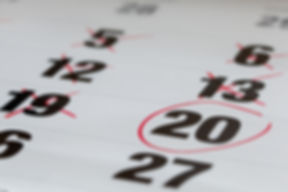 Red circle marked on a calendar and X Ma