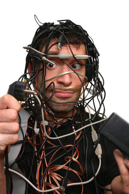 young man in cable chaos isolated on whi