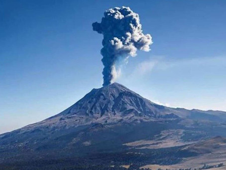 Mexican volcano's eruption captured from window of plane.