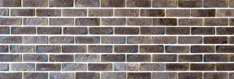 dark-brown-brick-wall-UYT2PDX (1).jpg