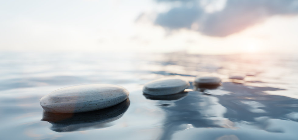 zen-stones-on-calm-water-at-sunset-spa-w