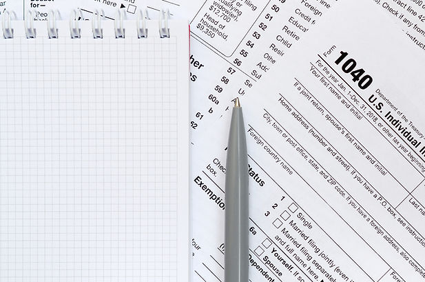 the-pen-and-notebook-is-lies-on-the-tax-