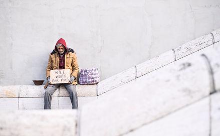 homeless-beggar-man-sitting-in-city-hold